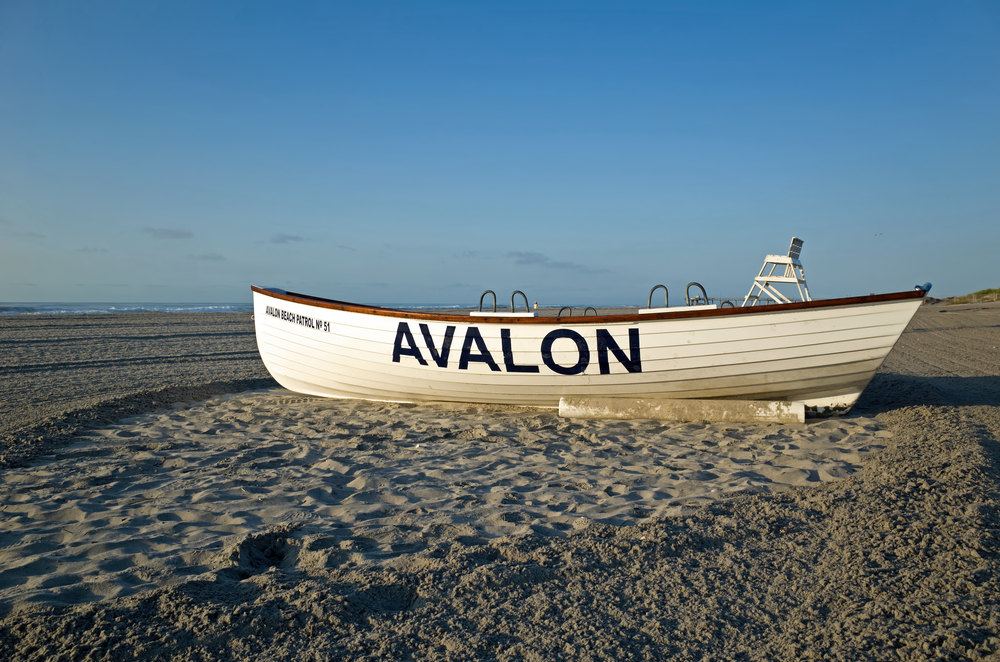AVALON, NJ, USA-AUGUST 27, 2014: Life boat resting on the beach in the early morning sun. Summer is winding down and the beaches are becoming deserted. M