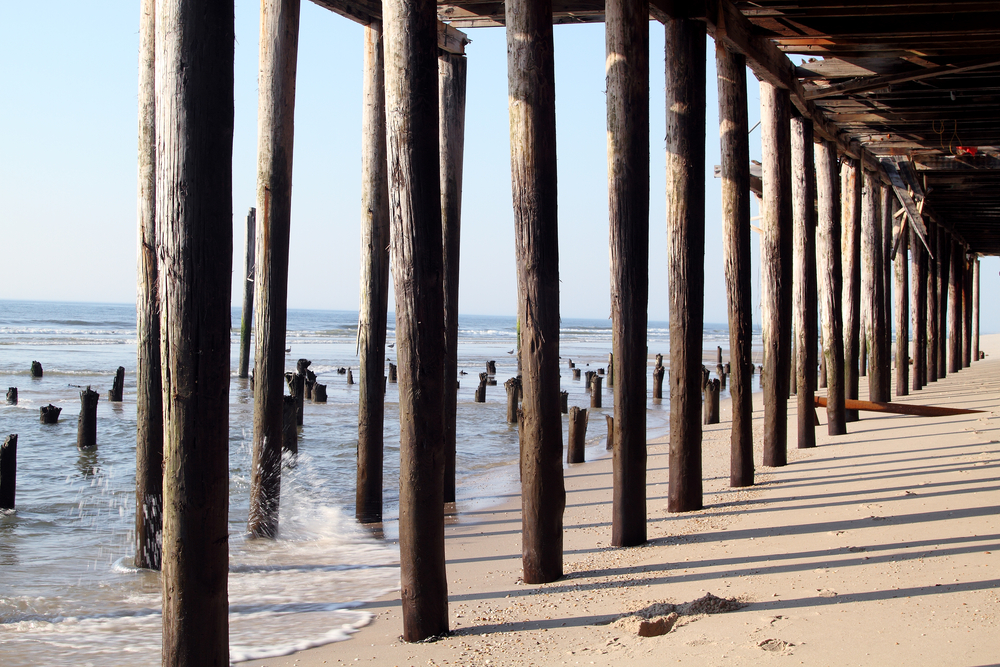 Long shadows are cast along the sand beneath the Fun Town Pier in Seaside Heights, New Jersey.
