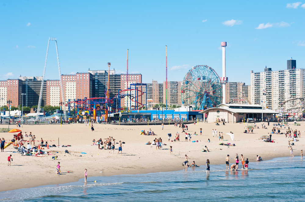 NEW YORK - JUNE 27: People on the beach on June 27, 2012 in Coney Island, NY. Coney Island beach is from West 37th St. at Sea Gate to the beginning of Manhattan Beach, approximately 2.5 mi (4.0 km).