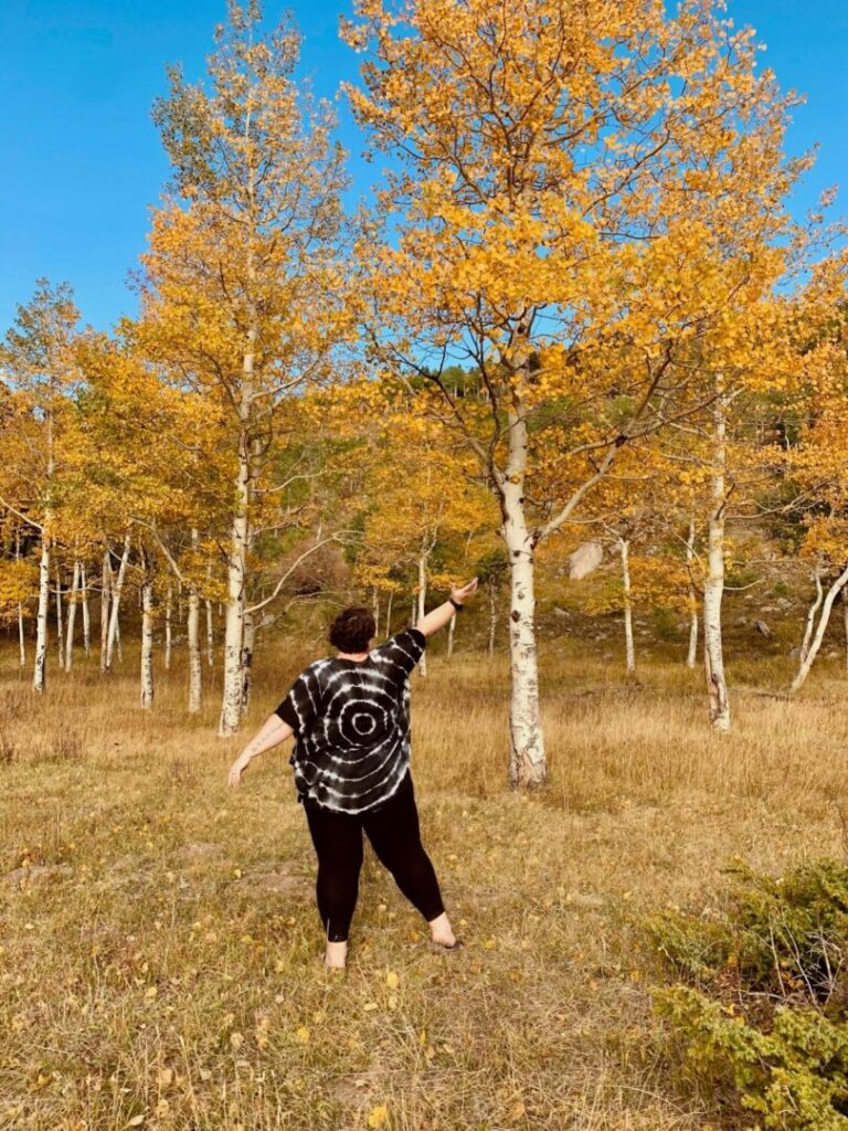 Woman enjoys a hike in Colorado during the fall