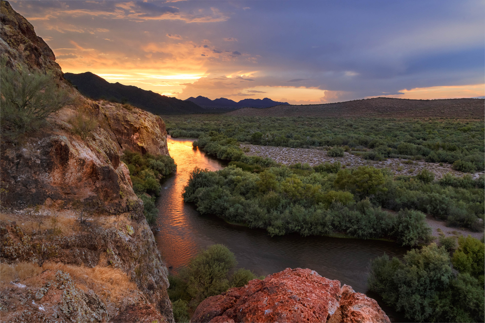 Scenic Landscape with flowing river and dramatic sky. Lower salt river, Arizona, USA.