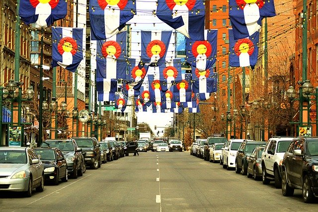 Colorado state flags decorate Larimer Street