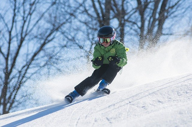 a boy skiing downhill