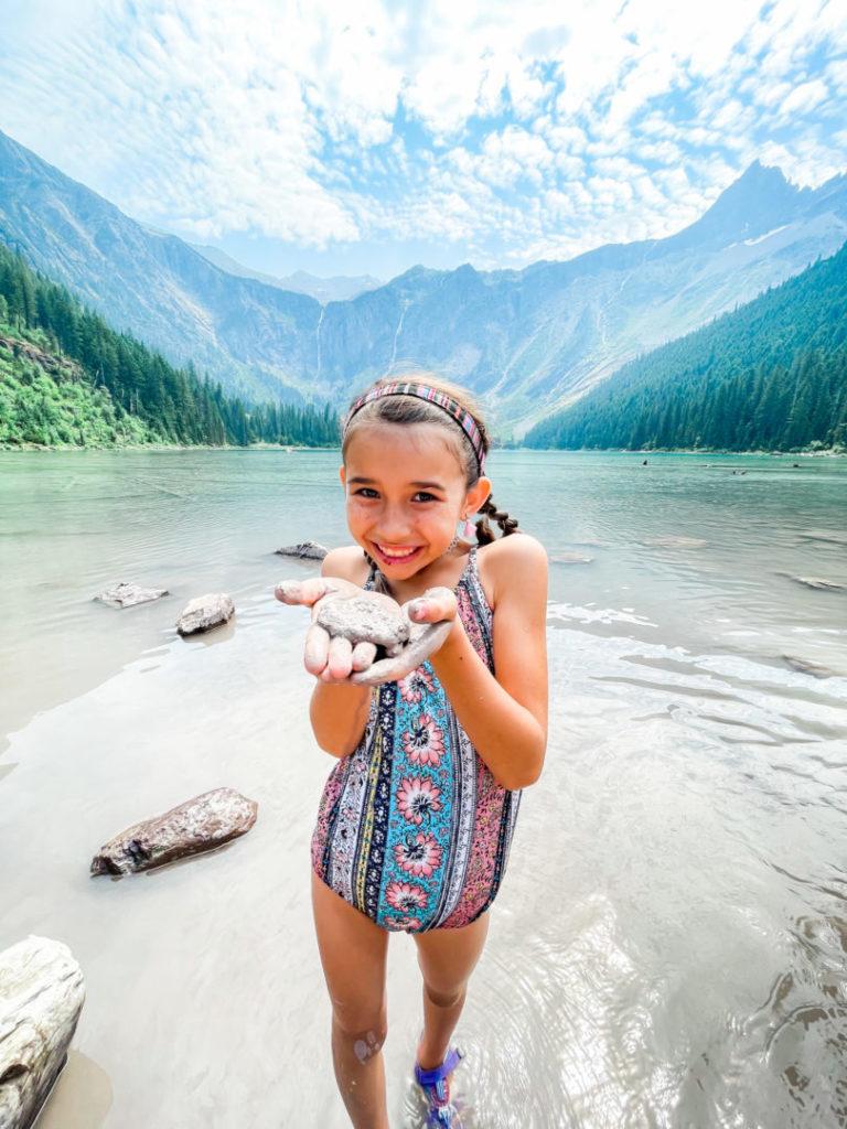 Little girl holds rock at Glacier National Park