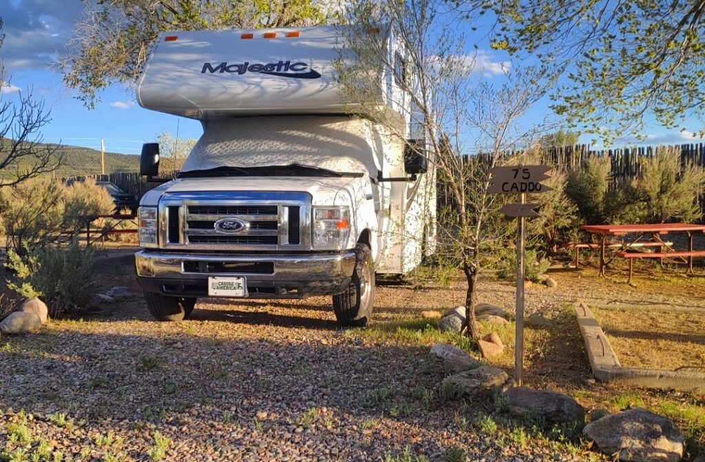 Class C RV parked at campsite