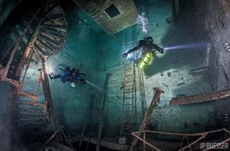 Scuba divers visit a flooded mine