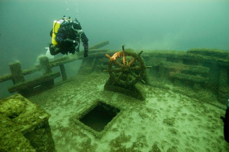 Scuba diver inspects sunken ship
