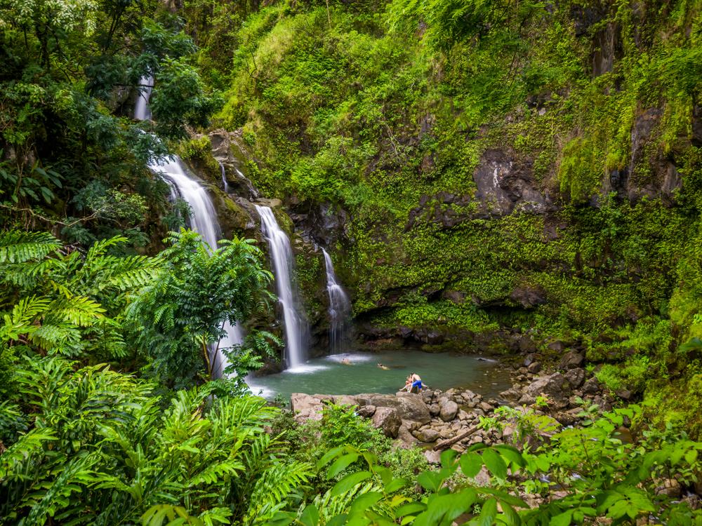 Maui, Hawaii Hana Highway - Three Bears Falls, Upper Waikani Falls. Road to Hana connects Kahului to the town of Hana Over 59 bridges, 620 curves, tropical rainforest.