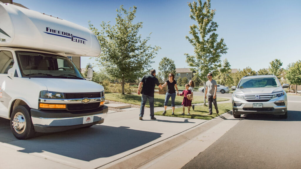 RV owner handing off RV rental to a family