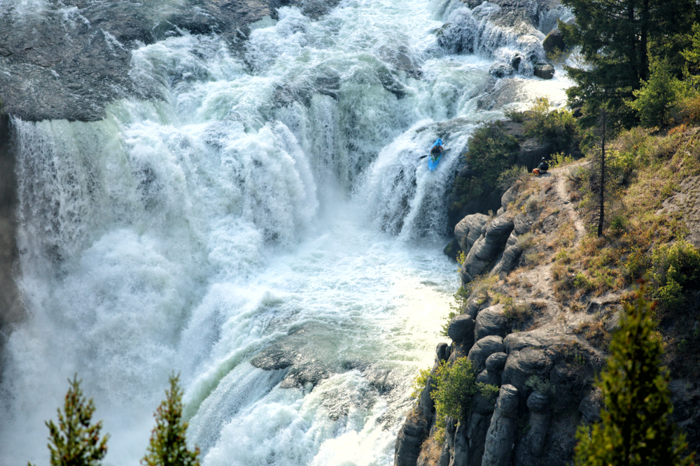 An experienced kayaker challenges the raging rapids of lower Mesa Falls on the Henry's Fork of the Snake River, in Idaho.