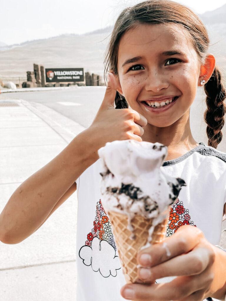 Little girl smiles with ice cream cone