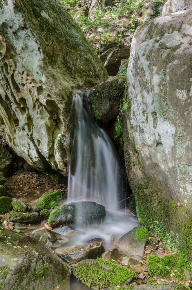 Water trickles over rocks after tumbling over Anglin Falls in central Kentucky