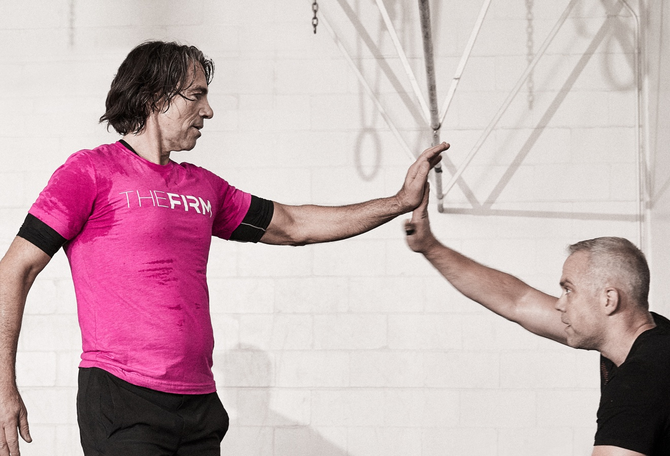 Instructor Jim S. encourages a personal training client