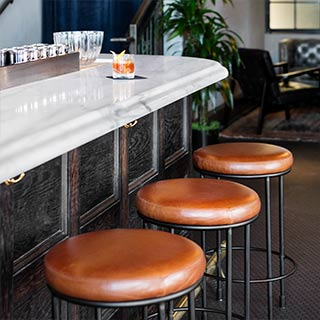 Leather seat barstools in lounge