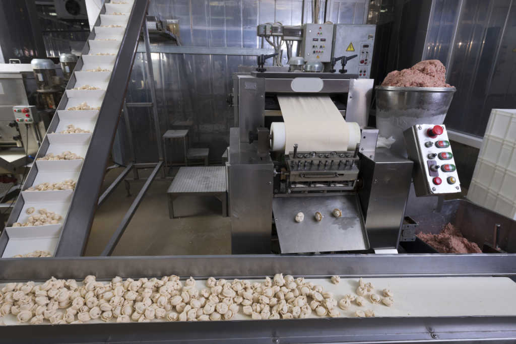 Food industry production line in ravioli (Dumplings (russian pelmeni) workshop.