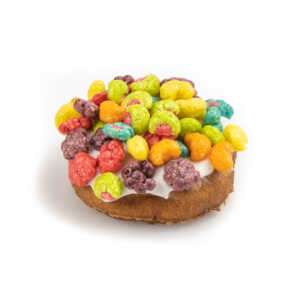 Cake donut topped with white icing and Trix Cereal