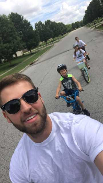 Broc on a bike ride with his niece and nephews