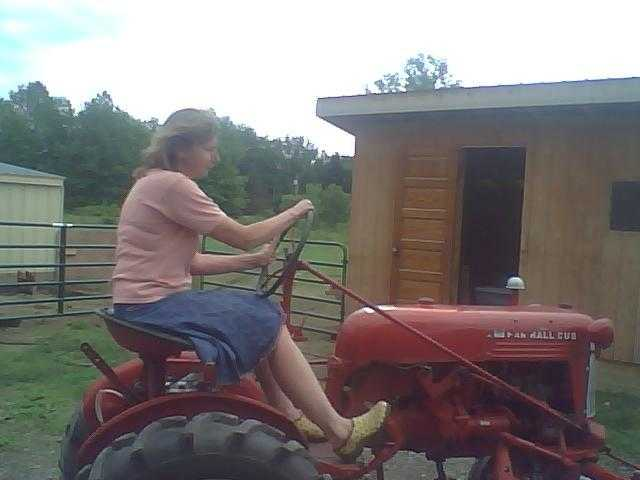 Valerie riding a tractor at Kelly Day Farms