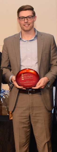 Shane Edwards receiving associate of the year award