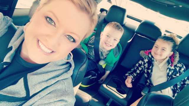 Trisha driving her two children to school