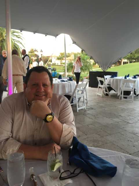 Nusbaum smiling under event tent