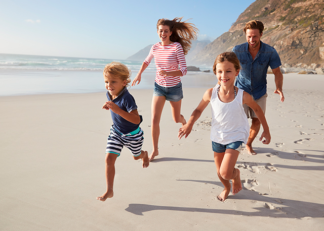 family-running-on-beach-web
