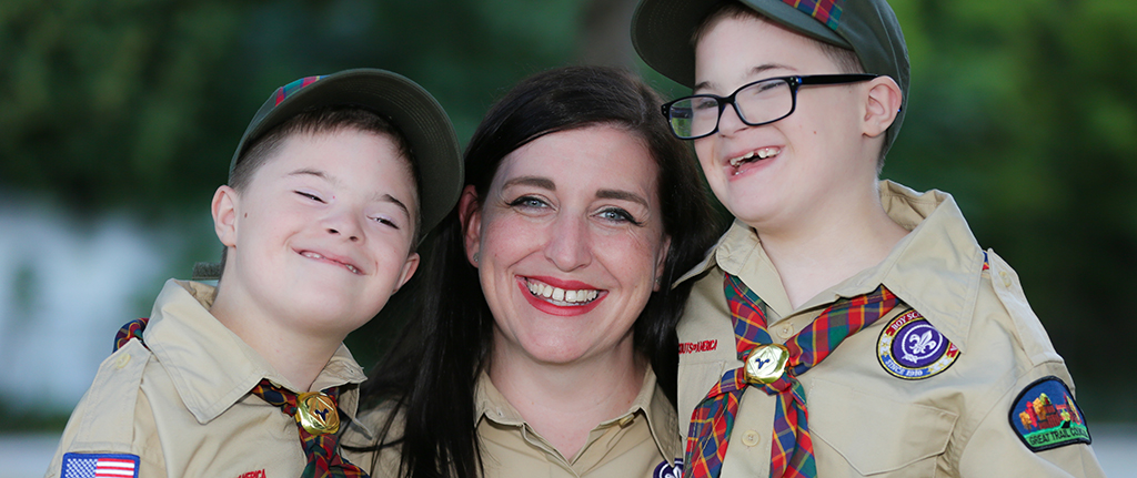 The Wilkinson family at a Cub Scout event. Board president. Mom. Mother. Family.