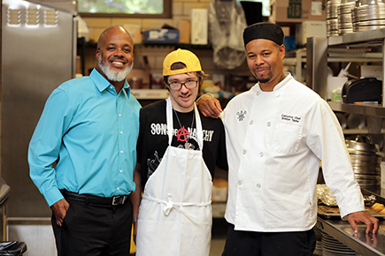 Mark Smelko working in the kitchen of the Akron Women's City Club with his SSA Vince Taylor and boss Briston Taylor.