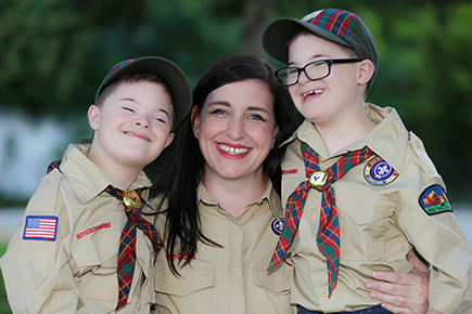 Casey and Connor with mom at Cub Scout event.