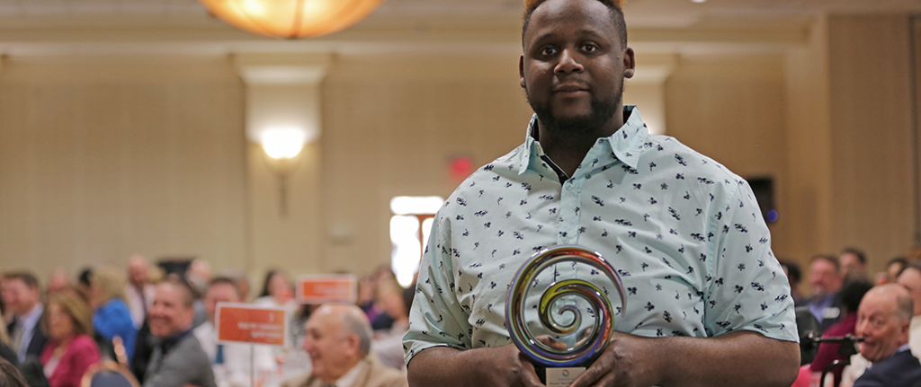 2019 Self-Advocate of the year award winner Shaq holding his award
