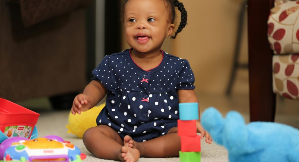 Cute toddler stacking blocks at an Early Intervention home visit