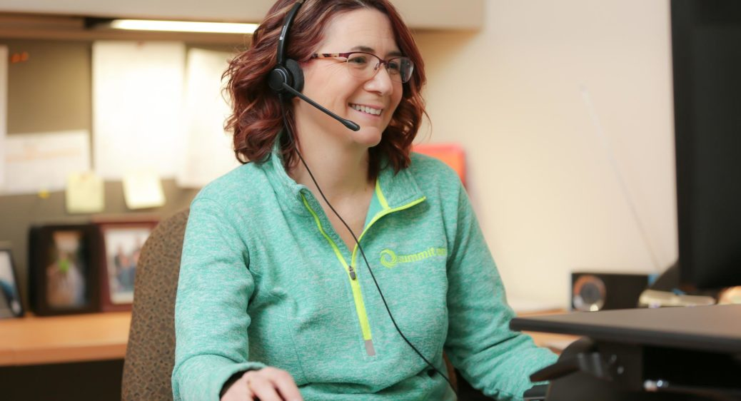 Smiling woman providing customer service