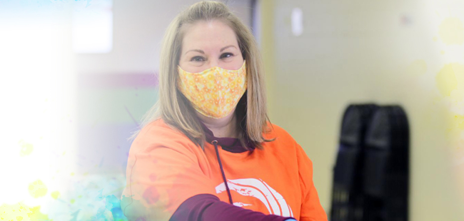 Summit DD Staff member wearing a face covering