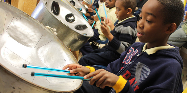 Boy playing steel drum