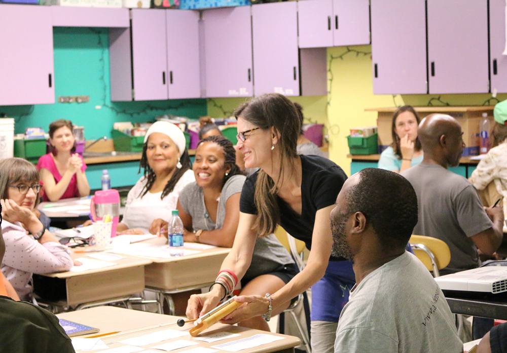 Young Audiences Arts Integration Specialist Kristina Berdan leading the arts-integrated Professional Development Week for teachers and artists Summer Arts and Learning Academy.