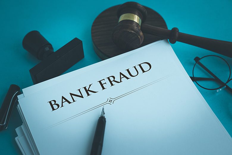 King pleads guilty to wire fraud, accused of negligence