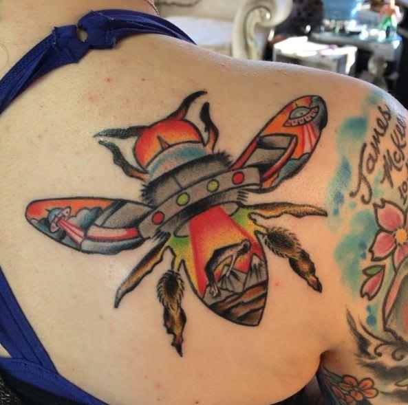 UFO tattoo by @craigmessina