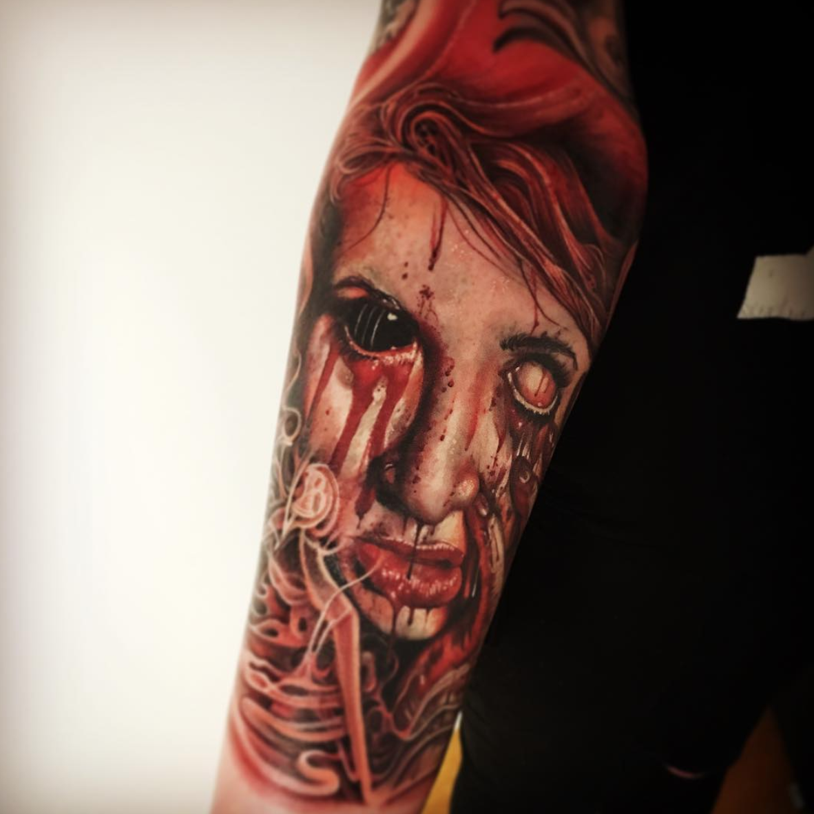 Bloody horror sleeve by @mario_hartmann_tattooist