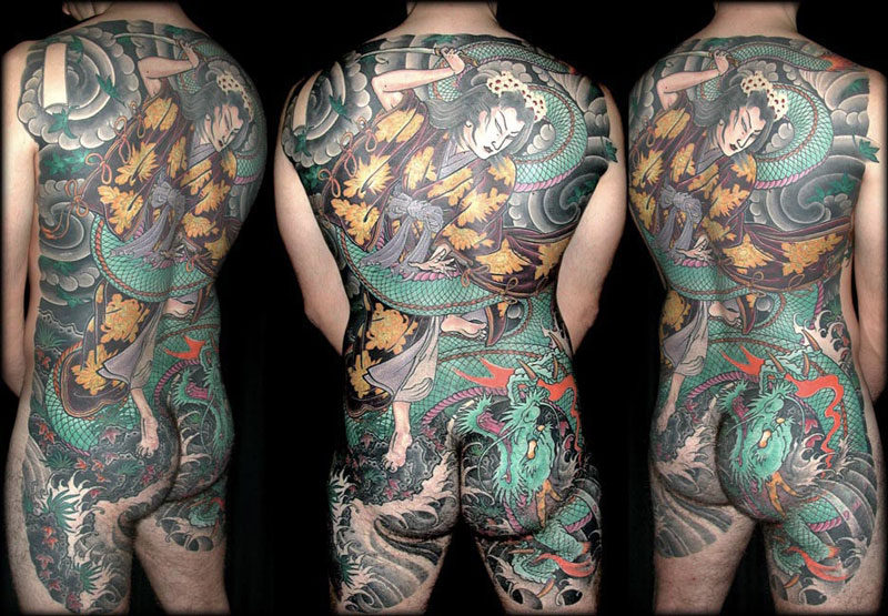 Full back piece tattoo by Filip Leu
