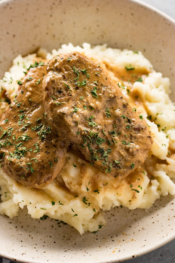 Crockpot pork chops are easy to make and smothered in gravy
