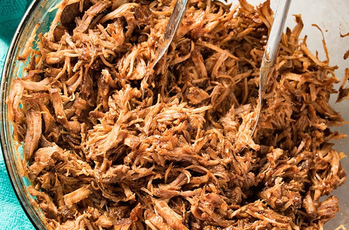 easy pulled pork recipe made in the instant pot with bbq sauce and pork loin