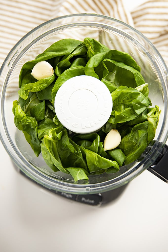 basil and garlic in food processor for basil pesto