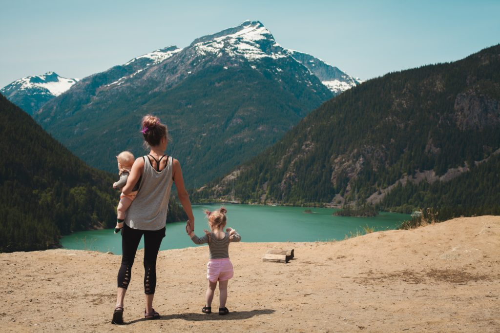 mom and daughter looking at mountain