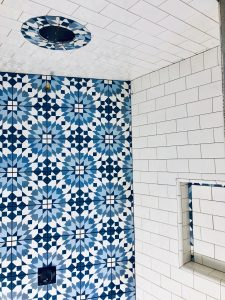 "This shower featured blue encaustic tile with 3""x 6"" subway tile."