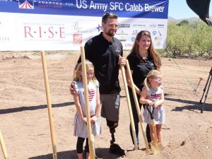 United States Army Sergeant First Class Caleb Brewer (Ret.) , with wife Ashley and daughters Evelyn and Emily at the groundbreaking.
