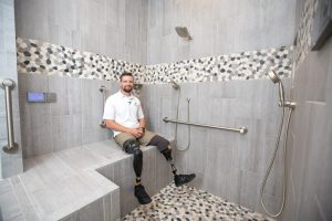 Caleb in the shower installed by NTCA member Mourelatos Tile Pro of Tucson.