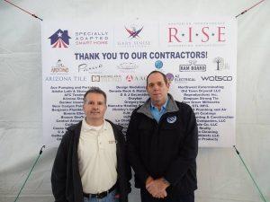 NTCA contractors John Mourelatos (l.) and James Woelfel at the home dedication.