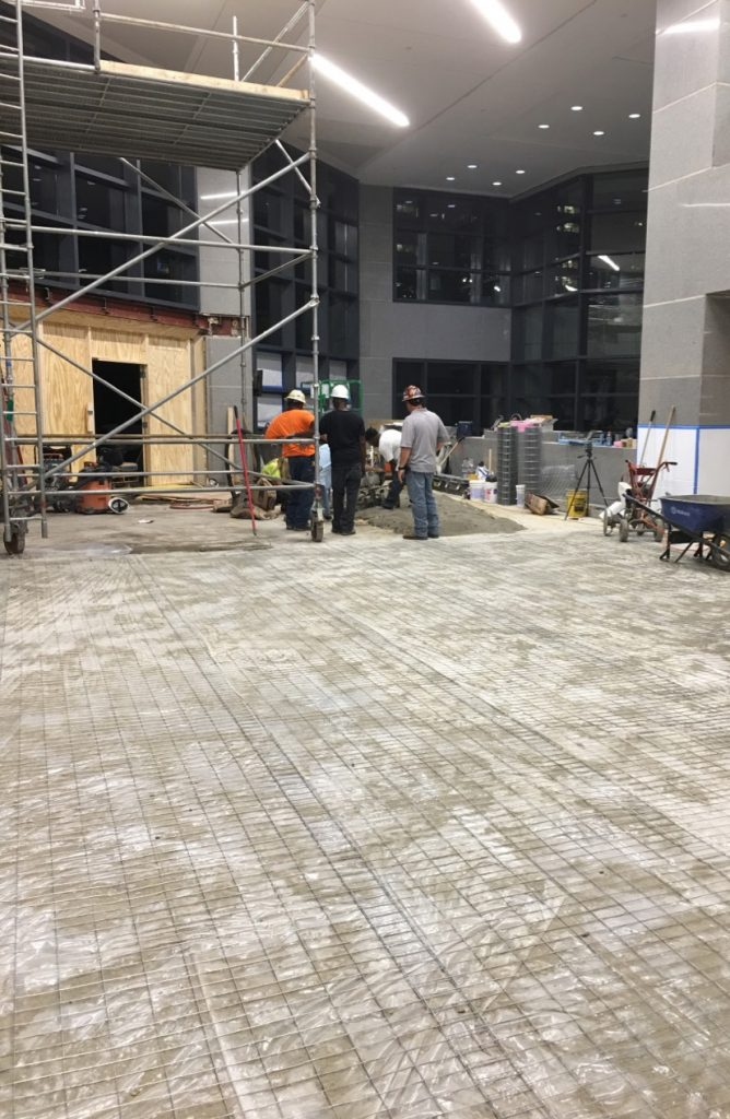 Prepping the floors in the lobby for installation.