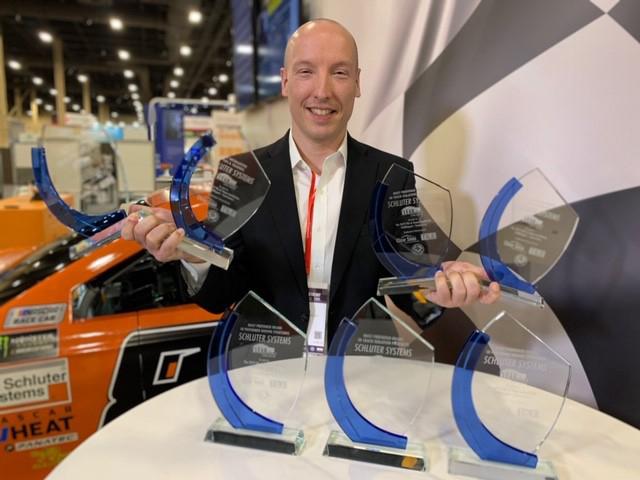 man with awards
