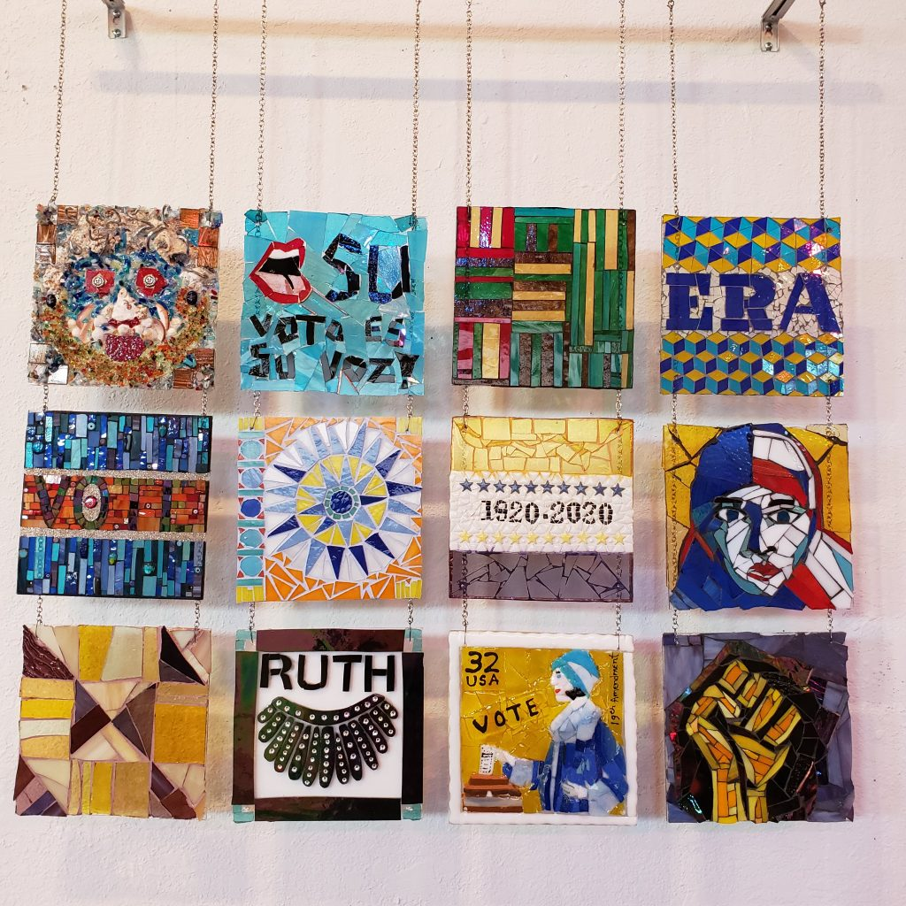 12 square mosaics form a quilt themed to women's voting rights